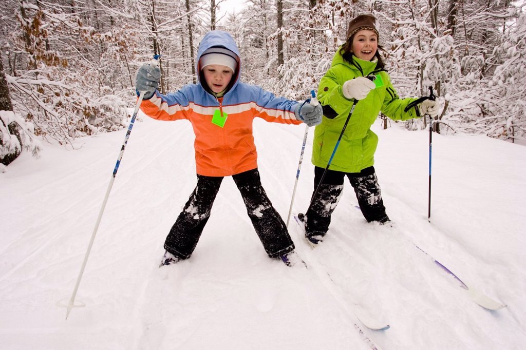 Stock Photo: 1778R-5998 Two young girls Cross Country Skiing in Dayton, Maine.