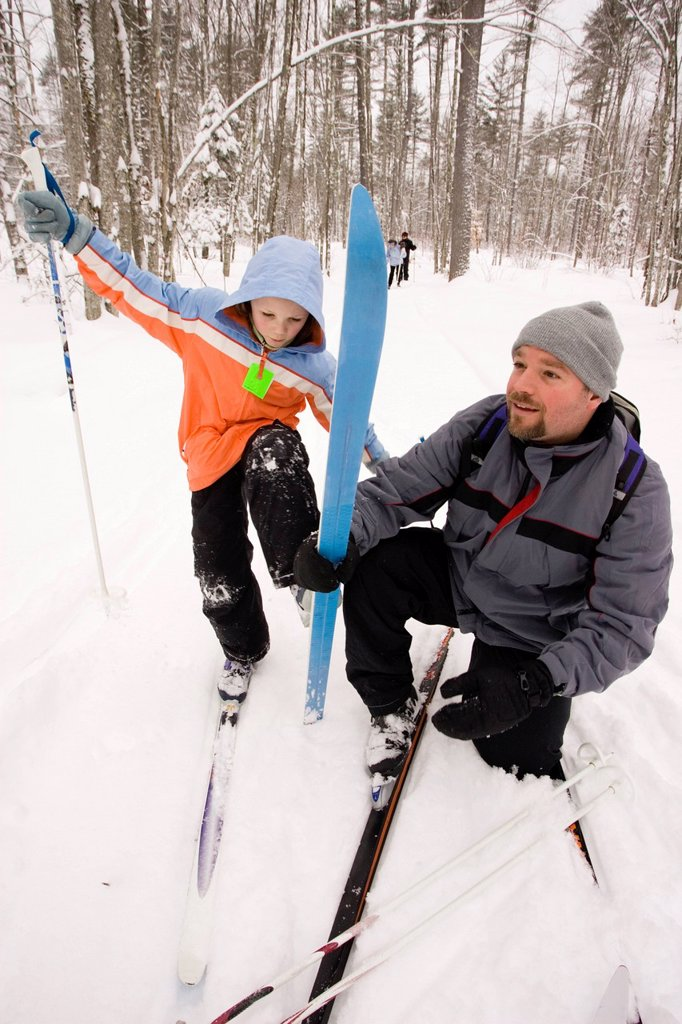 A family Cross Country Skiing in Dayton, Maine. : Stock Photo