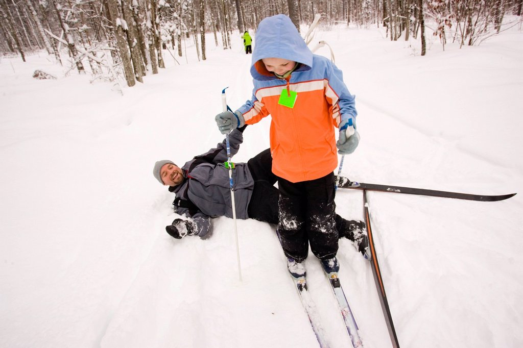Stock Photo: 1778R-6002 A family Cross Country Skiing in Dayton, Maine.