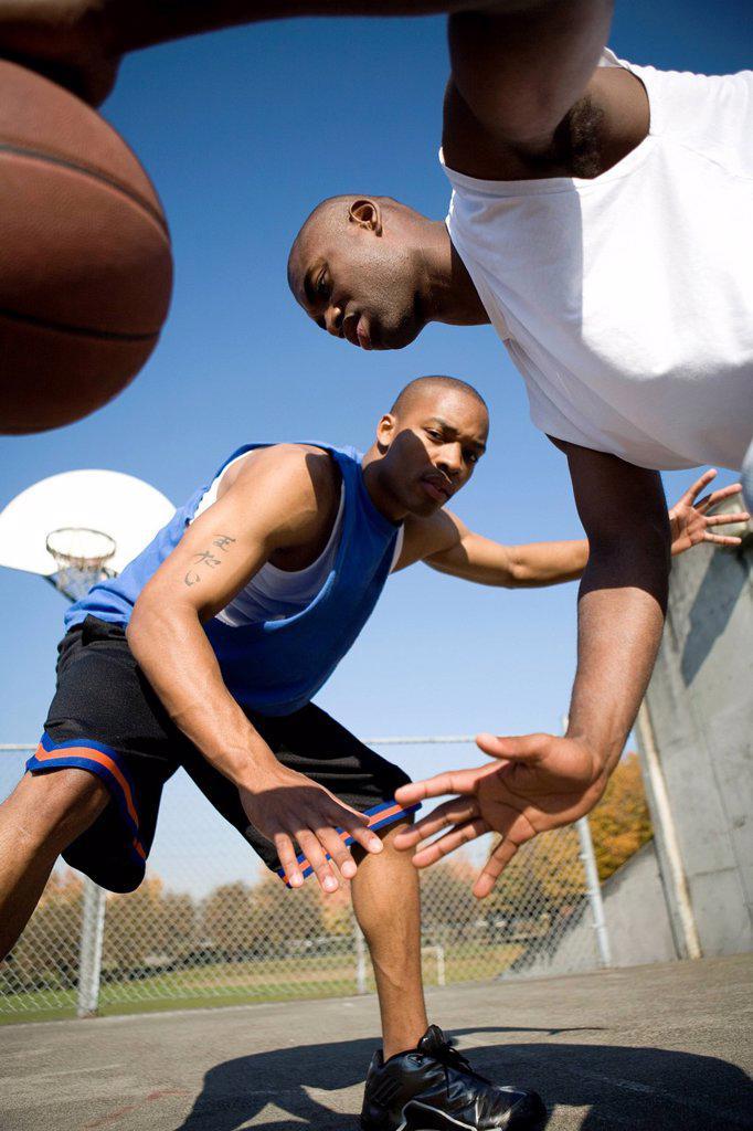 Stock Photo: 1778R-6057 Two men play basketball in Portland, Oregon.