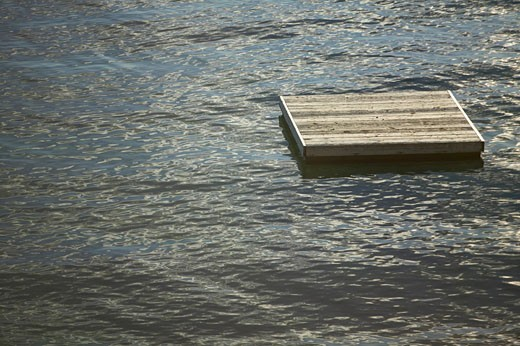 Stock Photo: 1779R-10629 Wooden raft in open water