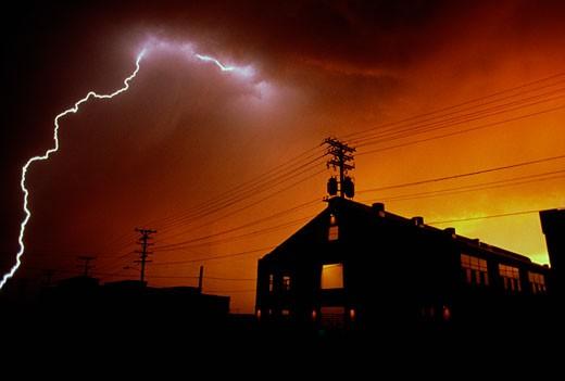 Stock Photo: 1779R-11075 Bolt of lightning over warehouse