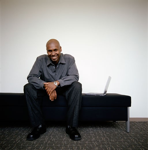 Stock Photo: 1779R-11081 African man with laptop smiling