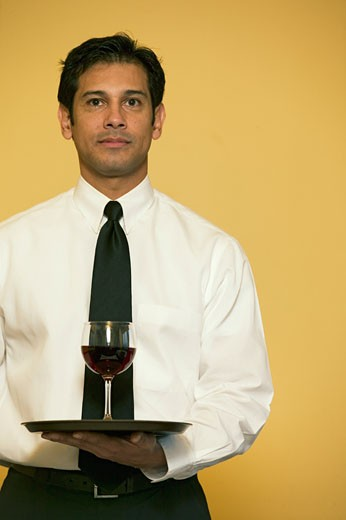 Stock Photo: 1779R-11386 Waiter holding glass of wine on tray