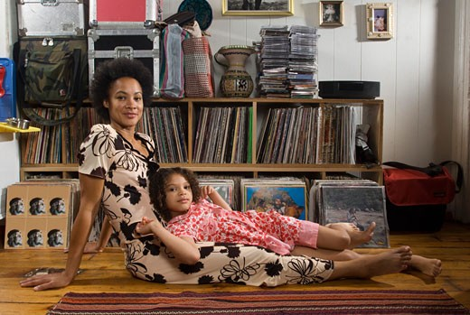 Stock Photo: 1779R-1153 Mother and daughter laying on living room floor