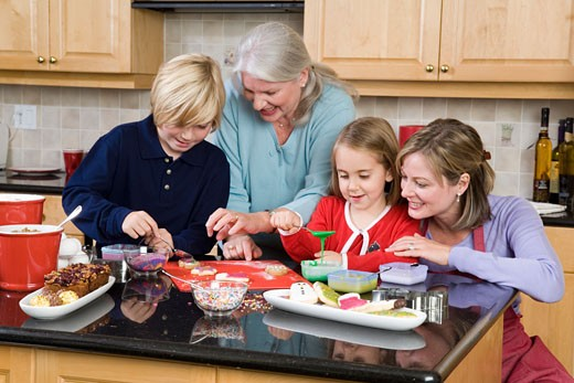 Stock Photo: 1779R-12071 Family making Christmas cookies