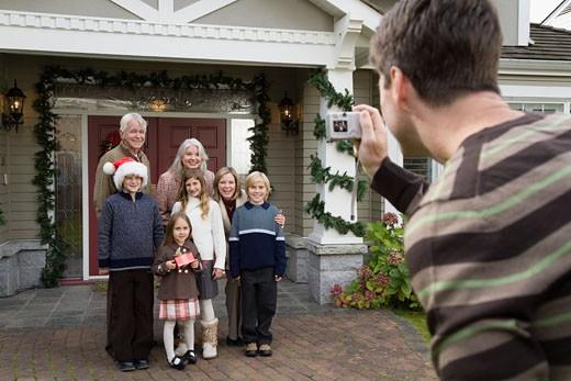 Man taking family Christmas portrait : Stock Photo