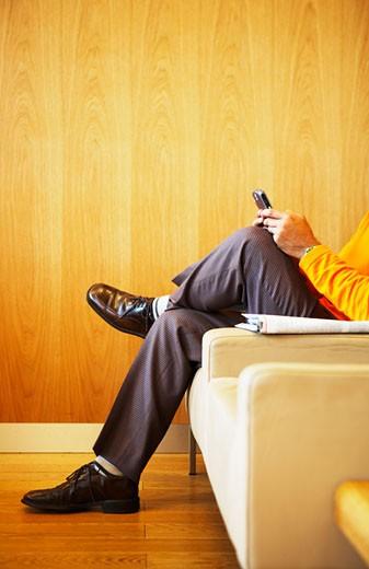 Stock Photo: 1779R-13018 Man text messaging