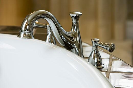 Stock Photo: 1779R-13330 Detail of bathroom sink
