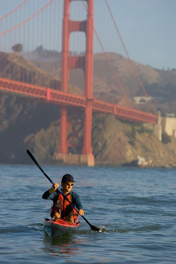 Stock Photo: 1779R-14274 Man kayaking underneath the Golden Gate bridge, San Francisco, California