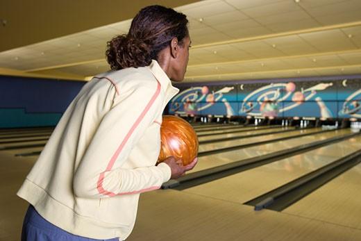 Woman bowling : Stock Photo