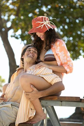 Young Hispanic couple hugging : Stock Photo