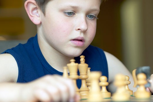 Stock Photo: 1779R-15272 Young boy playing chess