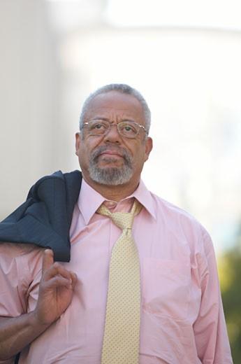 African businessman holding jacket over shoulder : Stock Photo