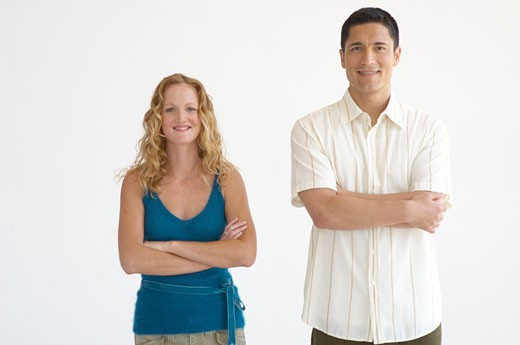 Couple standing with crossed arms : Stock Photo