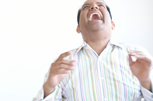 Hispanic man laughing : Stock Photo