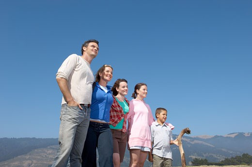 Stock Photo: 1779R-15783 Family posing in wilderness