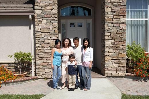 Stock Photo: 1779R-15838 Family posing outside their house