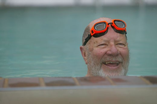 Mature man swimming : Stock Photo