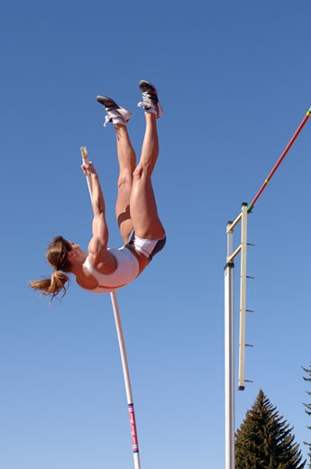 Stock Photo: 1779R-16349 Female athlete pole vaulting