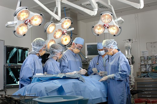 Surgeons operating on patient : Stock Photo