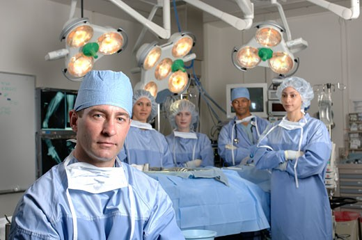 Surgeons in operating room : Stock Photo