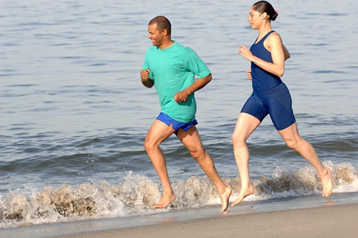 Stock Photo: 1779R-16464 African couple running on beach