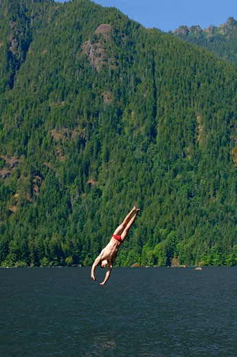 Man diving into lake : Stock Photo