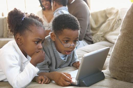 Children watching DVD player : Stock Photo