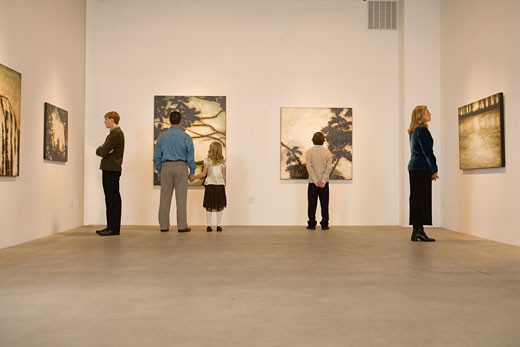 Family in art gallery : Stock Photo