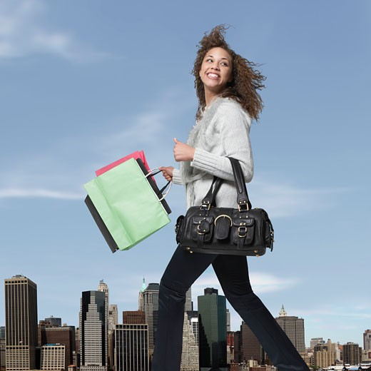 Stock Photo: 1779R-18309 Woman carrying shopping bags