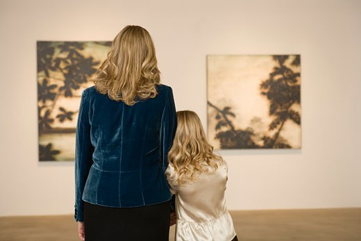 Mother and daughter in art gallery : Stock Photo