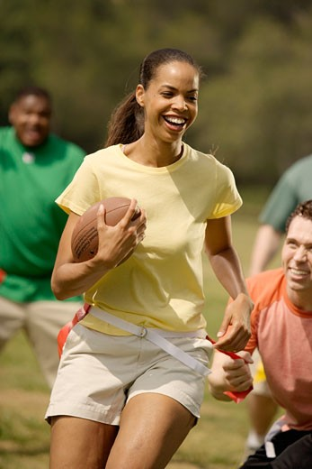 African woman playing football : Stock Photo