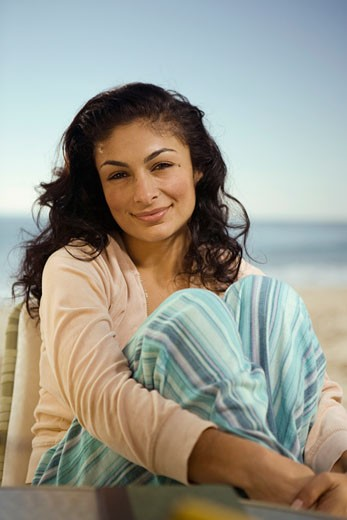 Hispanic woman smiling on beach : Stock Photo