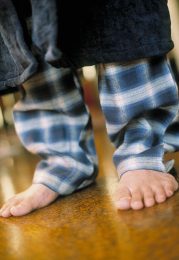 Man's legs in pajamas : Stock Photo