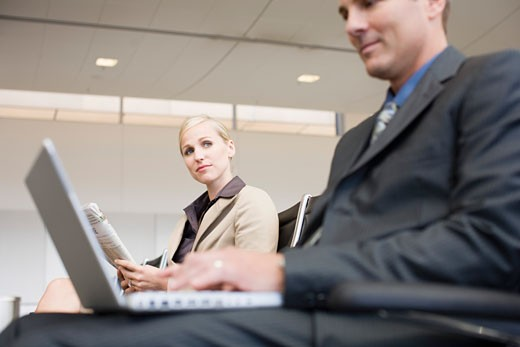 Stock Photo: 1779R-1985 Businesswoman looking at businessman