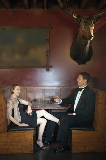 Couple in restaurant booth : Stock Photo