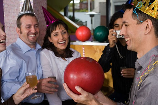 Birthday party with candle in bowling ball : Stock Photo