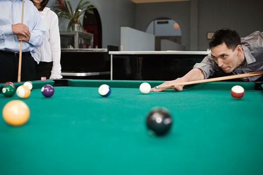 Stock Photo: 1779R-20069 Man playing pool