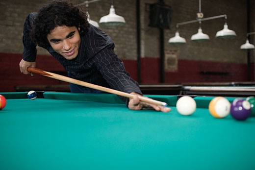 Hispanic man playing pool : Stock Photo