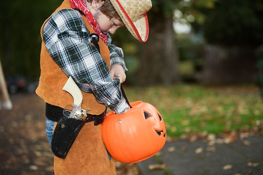 Young boy trick or treating on Halloween : Stock Photo