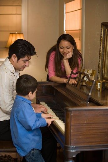 Family playing piano : Stock Photo
