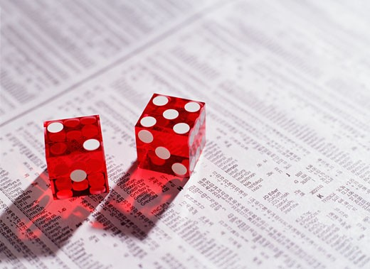 Stock Photo: 1779R-20743 Dice on newspaper