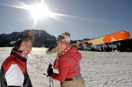 Couple walking up ski slope : Stock Photo