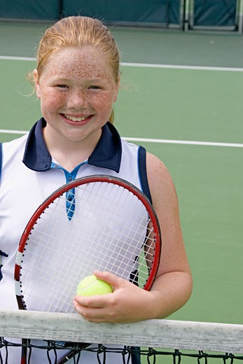 Stock Photo: 1779R-20801 Young girl playing tennis