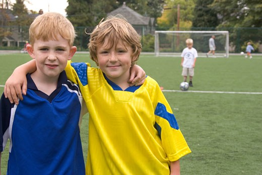 Two young soccer players hugging : Stock Photo