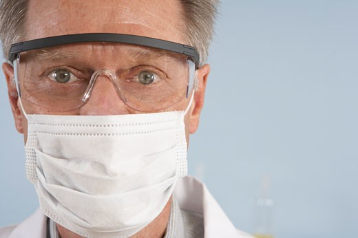 Stock Photo: 1779R-21408 Scientist wearing surgical mask and safety glasses