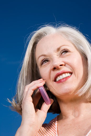 Stock Photo: 1779R-21442 Mature woman talking on cell phone