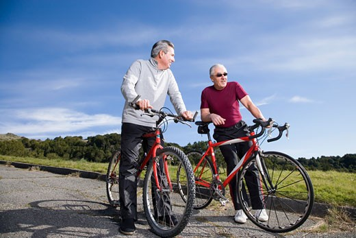 Mature men riding bicycles : Stock Photo