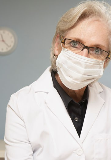 Female scientist wearing mask : Stock Photo